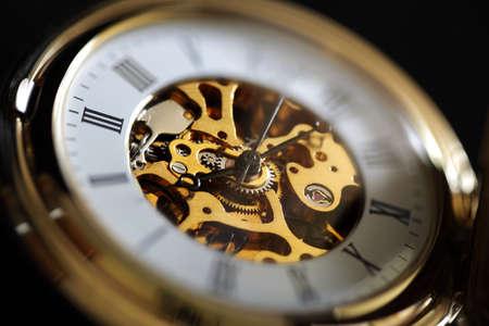 clock gears: Gold vintage pocket watch close up