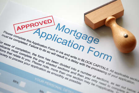 endorsing: Approved Mortgage loan application with rubber stamp Stock Photo