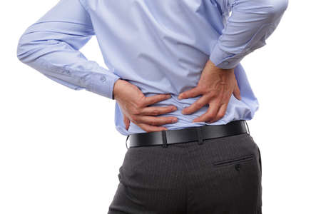 human back: Backache concept bending over in pain with hands holding lower back Stock Photo