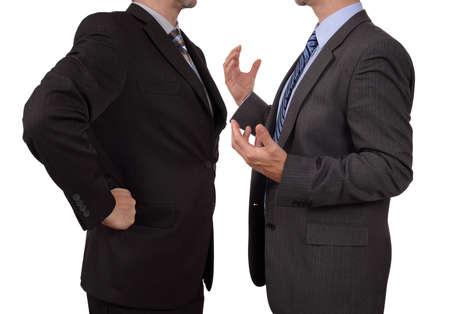 conflicto: Conflicto en el cargo excutive negocios que discute con su jefe en la reuni�n Foto de archivo
