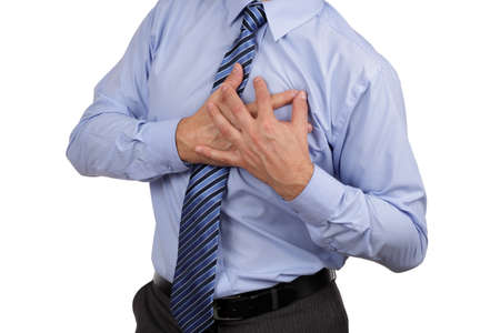 Businessman with chest pain clutching his chest concept for heart attack, stoke or asthmatic photo