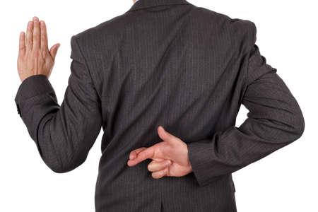 不正直またはビジネスの詐欺のためのバックの概念の背後にある交差指で宣誓を誓う 写真素材