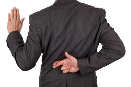 unethical: Swearing an oath with fingers crossed behind back concept for dishonesty or business fraud Stock Photo
