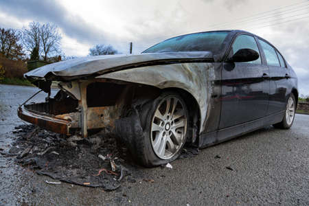 burnt out: Insurance claim concept burnt out car wreck