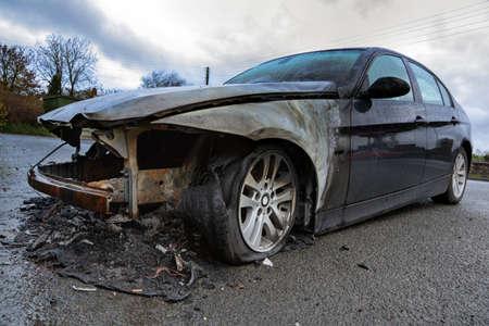 damaged car: Insurance claim concept burnt out car wreck