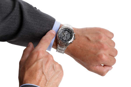 mans watch: Businessman checking the time on his wrist watch