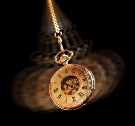hypnosis: Hypnotism concept, gold pocket watch swinging used in hypnosis treatment Stock Photo