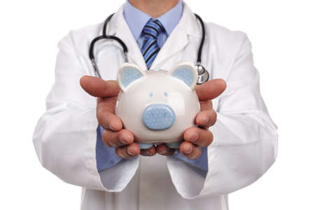 Doctor holding piggy bank concept for healthcare insurance fees and savings for medical expenses Stock Photo - 25087787