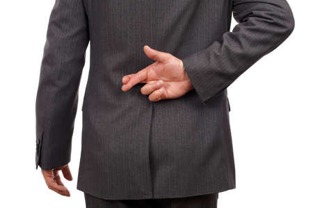 finger crossed: Businessman with his fingers crossed behind his back - concept for good luck or dishonesty Stock Photo