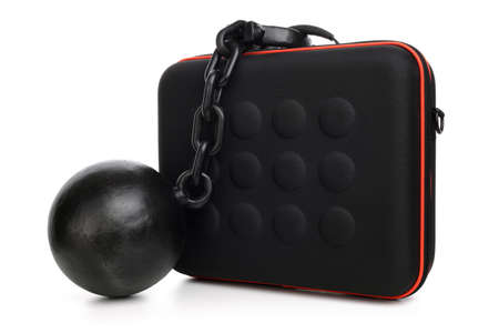 restraining device: Ball and chain attached to a briefcase concept for chained to your work, overworked or security Stock Photo
