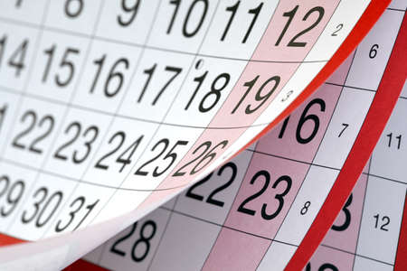 calendar day: Months and dates shown on a calendar whilst turning the pages Stock Photo