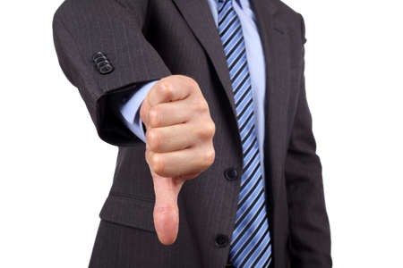 Business failure, businessman gesturing a thumbs down in displeasure photo