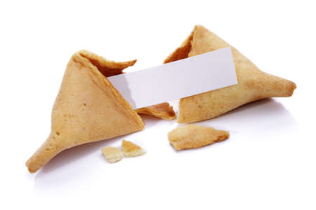 Fortune cookie with blank paper on white background photo