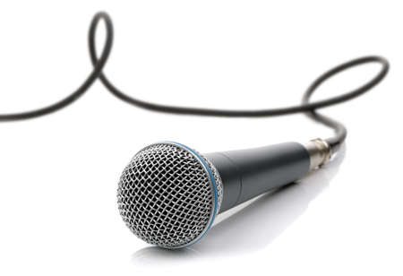 conference speaker: Microphone with cable connected ready for an interview, singing or recording music isolated on white