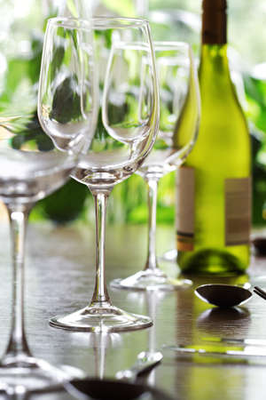 stereotypically: Restaurant table with silverware, white wine and wine glasses