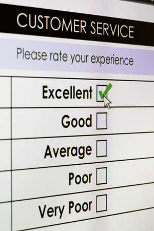 Tick placed in excellent checkbox on customer service satisfaction survey form on digital tablet screen Stock Photo
