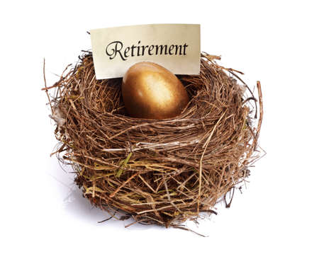 nest egg: Golden nest egg concept for retirement savings Stock Photo