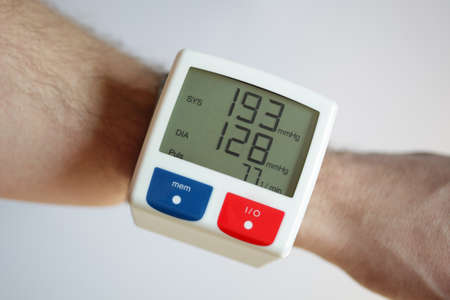 high blood pressure: Blood pressure monitor with very high reading concept for illness and heart risk