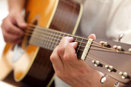 Man playing an acoustic guitar photo