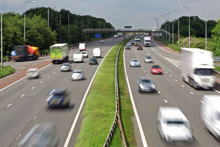 highway signs: Heavy traffic moving at speed on the M6 motorway in England