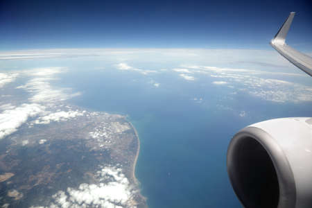 private jet: View from an aeroplane window of sea and coast
