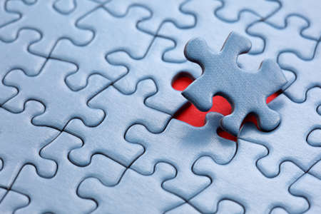 problems solutions: The last piece of jigsaw puzzle concept for solution and completion Stock Photo