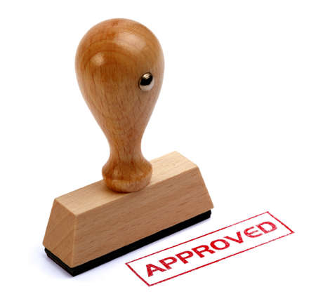 rubber stamp: Rubber stamper with the word APPROVED printed in red Stock Photo
