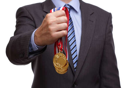 Business success businessman holding gold medals photo