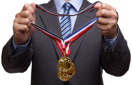 Businessman giving gold medal prize for success in business photo