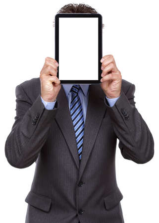 Businessman holding up a blank tablet pc in front of his face photo