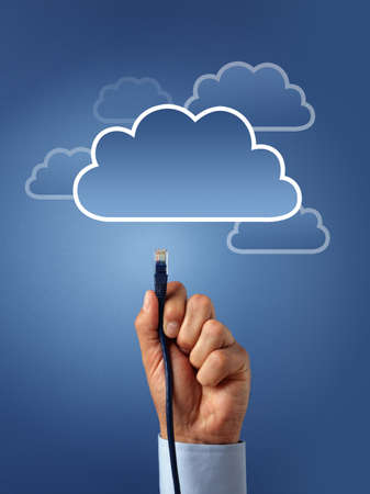 Concept for cloud computing - busnessman hand connecting to the cloud with ethernet cable photo