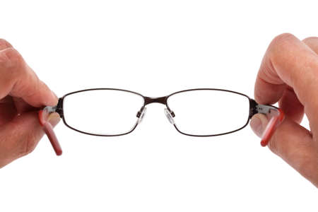 point of view: Hands holding eye glasses in front of white  Stock Photo