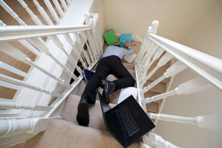 Business man falling down the stairs in the office  photo
