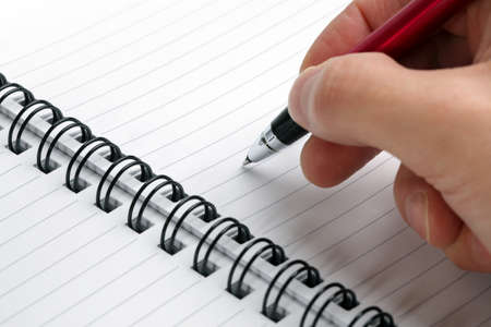 copy writing: Writing notes or planning a schedule on blank spiral notebook for copy