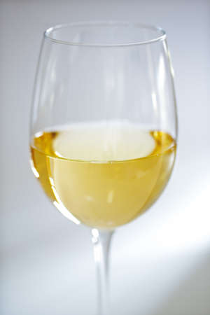 pinot grigio: Glass of white wine against white with soft focus Stock Photo