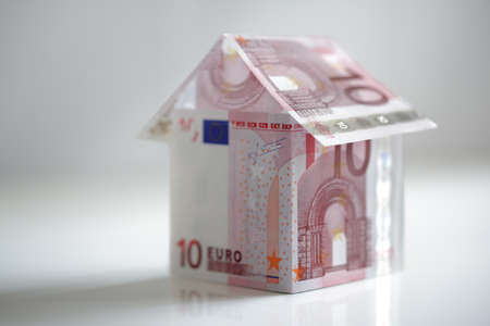 house prices: House made from ten euro banknotes concept for property prices, mortgage or home finances