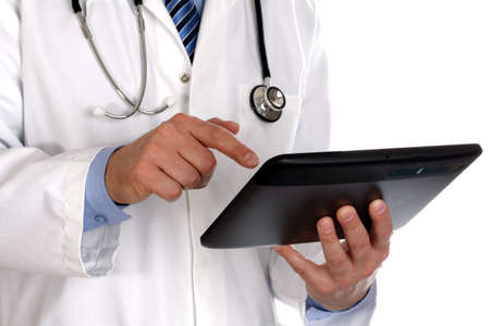 doctors tool: Doctor using a digital tablet on white