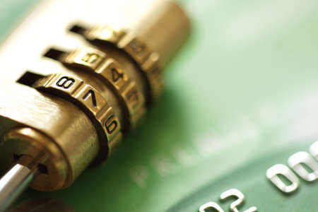 number lock: Credit card security concept with combination lock padlock Stock Photo
