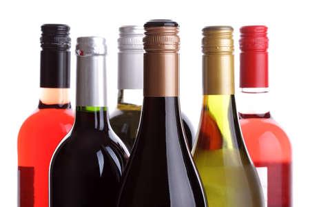 white wine glass: Wine bottles on a white  Stock Photo
