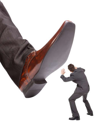 trample: Businessman foot about to stamp out the competition concept for business problems, bullying or hostile take over