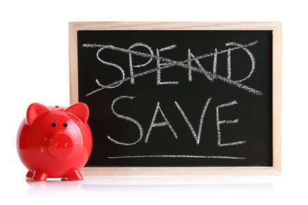 Piggy bank with blackboard and words spend and save photo