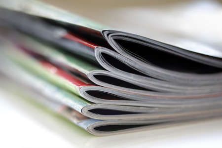 differential focus: Magazines with selective focus on foreground edge