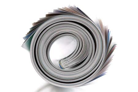 magazine stack: Magazine rolled up on white  Stock Photo