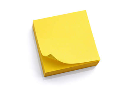 block note: Blank yellow sticky note block isolated on white