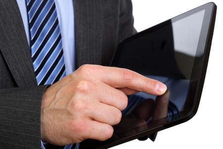 Businessman finger touching screen on tablet-pc photo