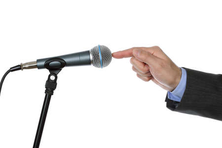 public address: Businessman testing a microphone about to make a speach at a press conference