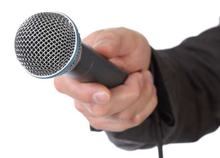 Mans hand holding a microphone conducting an interview photo