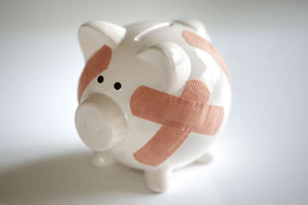 economic depression: Piggy bank with plasters concept for financial crisis or economic depression Stock Photo