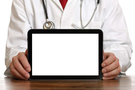 Doctor holding up and showing digital tablet with a blank screen. Stock Photo
