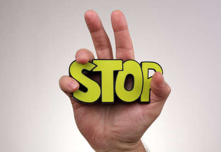 injunction: Stop gesture with hand holding stop sign